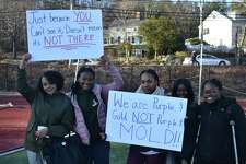 Students at Westhill High School in Stamford staged a walkout on Monday to raise awareness about the effects the mold in their school has on their health.