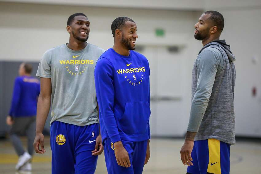 (l-r) Warriors players Kevon Looney, Andre Iguodala and DeMarcus Cousins during Golden State Warriors' practice in Oakland, California, on Monday, Nov. 26, 2018.