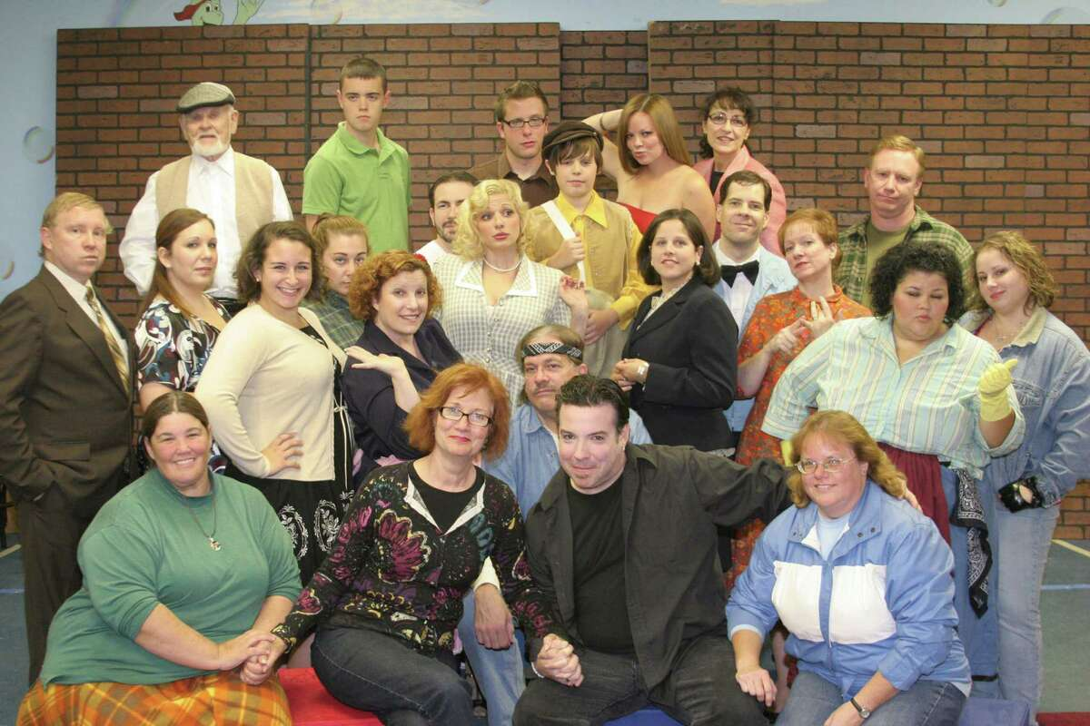 Thomas Dalton Bambury, in black in the front row, with the cast of the 2010 Not So Common Players production of the musical