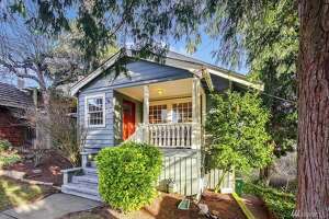 This Crafstman is tucked away on an unusually quiet street in North Admiral with 89 on Walkscore. Conveniently located and tastefully updated, this three-bedroom and two-bathroom house also offers a detached studio space for a home office.   2328 Walnut Ave. S.W., listed for $875,000.  See the full listing here .