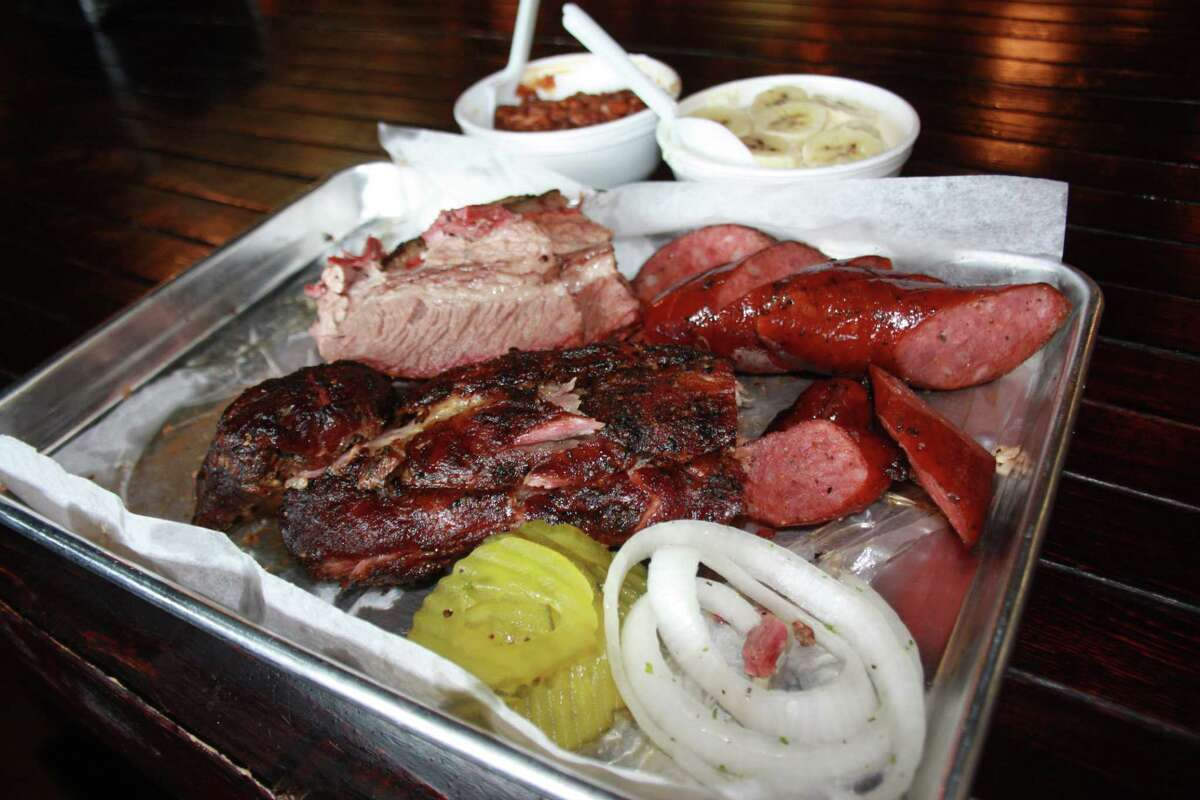 The Dee Willie's BBQ Smokehouse trinity of babyback pork ribs, brisket and sausage.