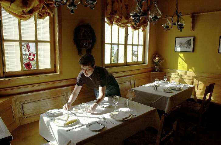 MATTERHORN2-C-05FEB03-FD-CL Matterhorn restaurant at 2323 Van Ness Avenue in San Francisco. Photo of Brigitte Thorpe, co-owner with her husband, Andrew, setting up a table. Photo by Craig Lee/San Francisco Chronicle