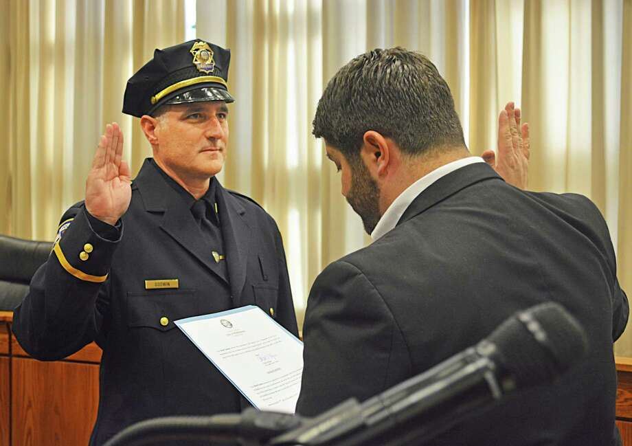 Middletown Mayor Dan Drew swears in Lt. David Godwin. Photo: Cassandra Day / Hearst Connecticut Media