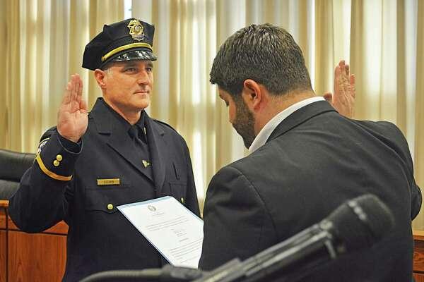 Middletown Mayor Dan Drew swears in Lt. David Godwin.