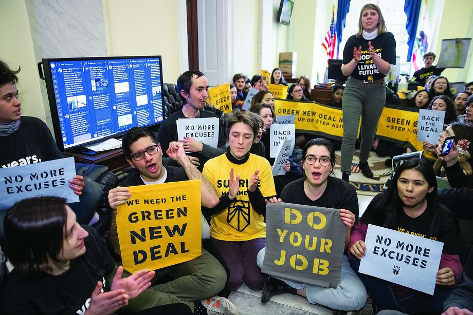 Environmental activists occupy the office of House Democratic Leader Nancy Pelosi of California, the speaker-designate for the new Congress, as they try to pressure Democratic support for a sweeping agenda to fight climate change, on Capitol Hill in Washington, Monday, Dec. 10, 2018. Photo: J. Scott Applewhite, Associated Press