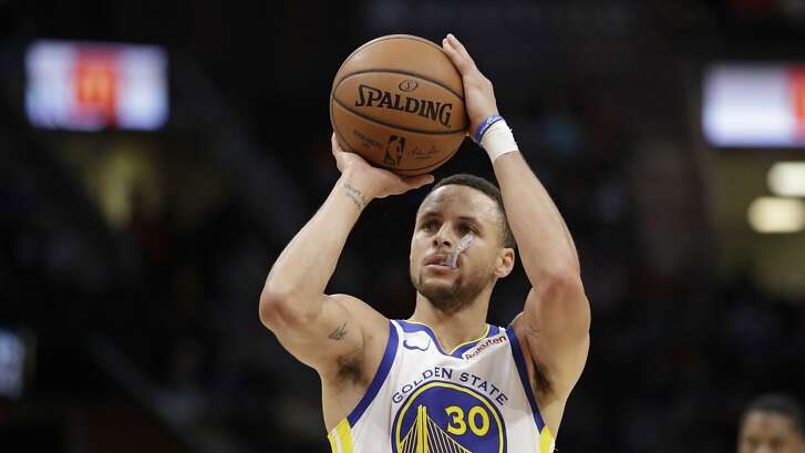 Golden State Warriors' Stephen Curry shoots in the second half of an NBA basketball game against the Cleveland Cavaliers, Wednesday, Dec. 5, 2018, in Cleveland. (AP Photo/Tony Dejak)