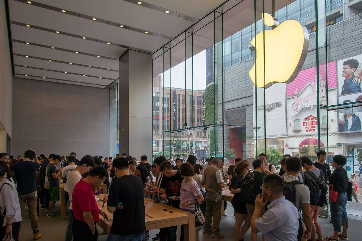 People experience the newly released iPhone XS, iPhone XS MAX and iPhone XR at the Apple Store in Shanghai, China, Sept. 21, 2018. (Sipa USA/TNS)