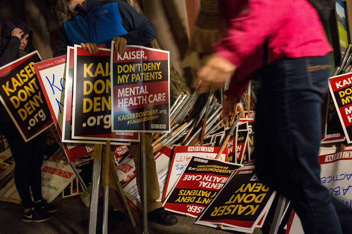 Signs are prepared for a protest outside Kaiser Permanente San Francisco Medical Center on Monday, December 10, 2018 in San Francisco, Calif.