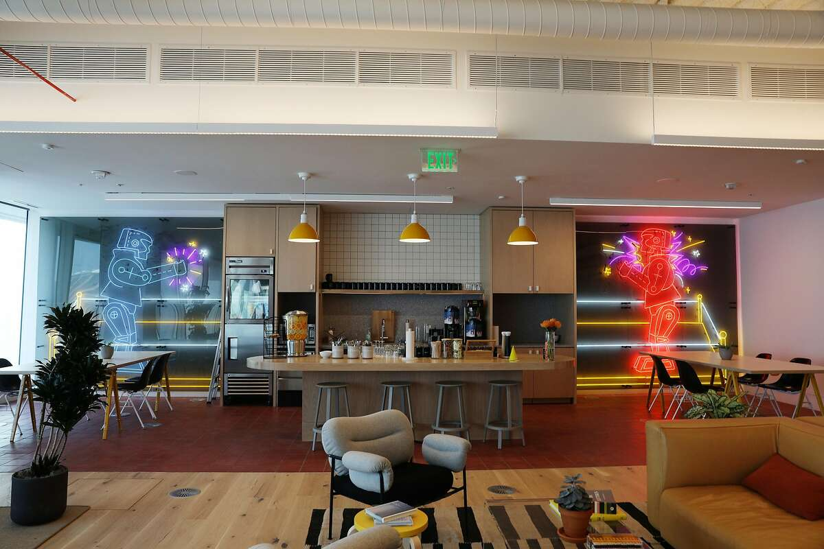 A common dining area is seen at Wework's new dual headquarters in Salesforce Tower on Monday, November 19, 2018 in San Francisco, Calif.