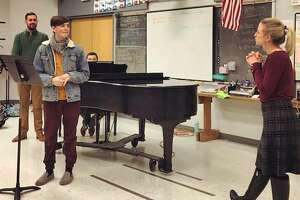 Opera Edwardsville teaching its Masterclass 2018 at Edwardsville High School last month with Opera Edwardsville founder and president, Chase Hopkins, background left, Joseph Welch on piano, EHS choral student Caleb Kelahan, foreground left, and Julie Tabash Kelsheimer, soprano, who was there as a guest instructor of Opera Edwardsville.