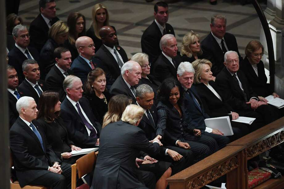 President Donald Trump and first lady Melania Trump greet former President Barack Obama and Michelle Obama at the state funeral for former President George H.W. Bush at the National Cathedral. Photo: Washington Post Photo By Matt McClain / The Washington Post