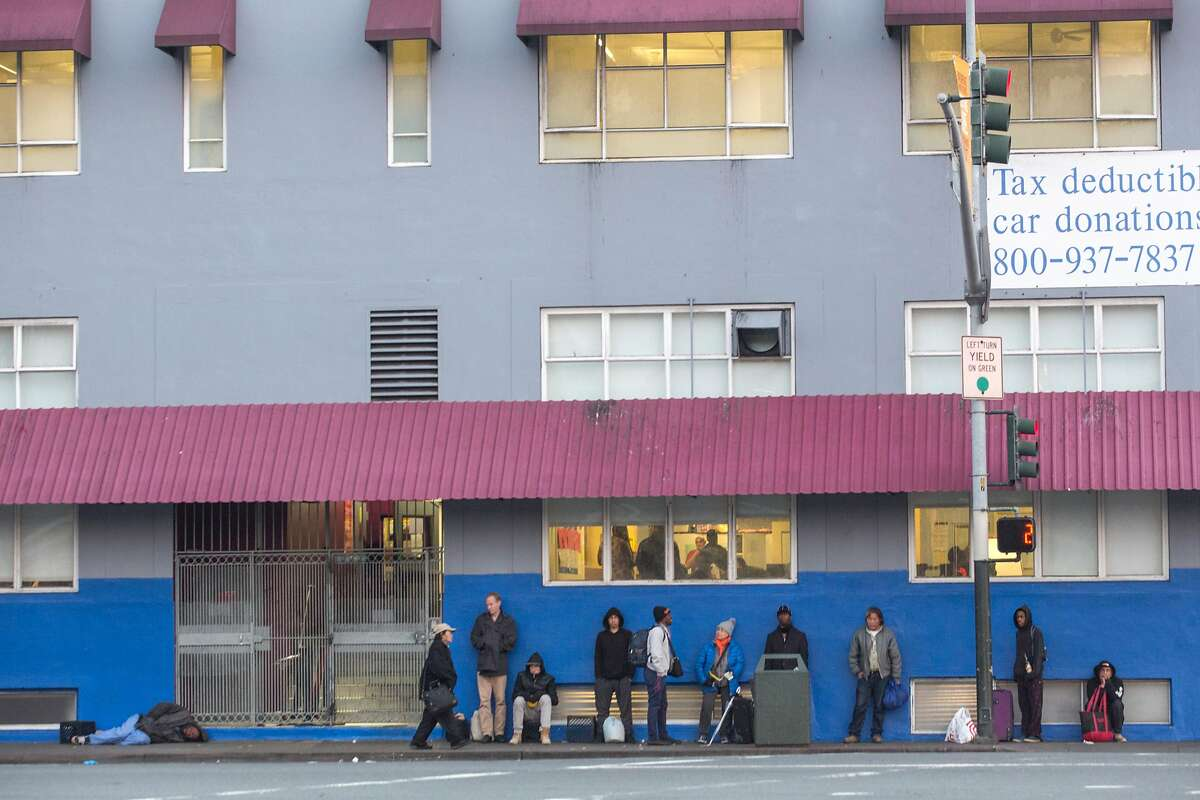 Patrons lining up outside of the St. Vincent de Paul shelter before it opens at 5 p.m on Sunday, December 9, 2018 in San Francisco, Calif.