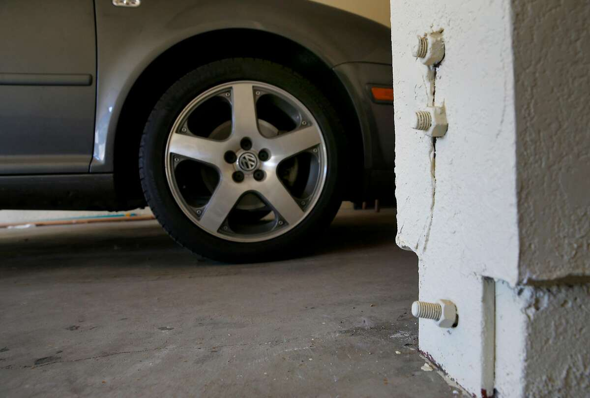 Bolts anchoring a column to the foundation are seen in the garage of the Capri Apartments on Linda Avenue in Oakland.