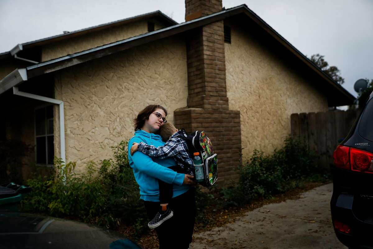 (l-r) Hillary McDaniel holds her son Landon McDaniel, 5,the day before moving to Oregon because they lost their home in Paradise in the Camp Fire in Chico, California, on Tuesday, Dec. 4, 2018.