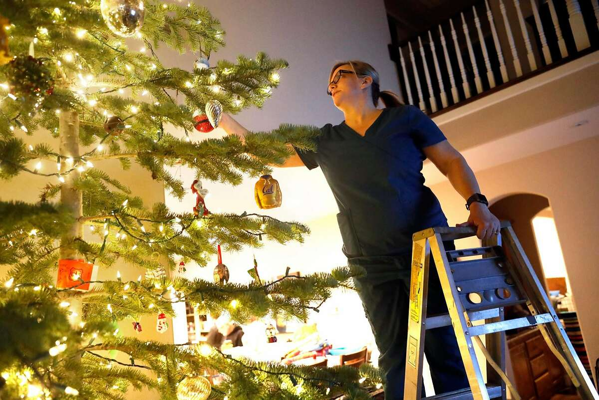 Nursing student and Adventist Health Feather River Hospital unit secretary Leslie Timm decorates a Christmas tree at her temporary residence at her sister's home in Chico, Calif.. Timm lost both her home and her job in the Camp Fire. Photographed on Thursday, December 6, 2018.