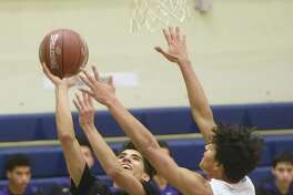 Warren's Isaac Gamboa, left, scored 24 points and snared six rebounds in a district victory over Stevens. Gamboa made six 3-pointers.