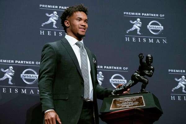 Oklahoma quarterback Kyler Murray holds the Heisman Trophy after winning the award Saturday, Dec. 8, 2018, in New York. (AP Photo/Craig Ruttle)