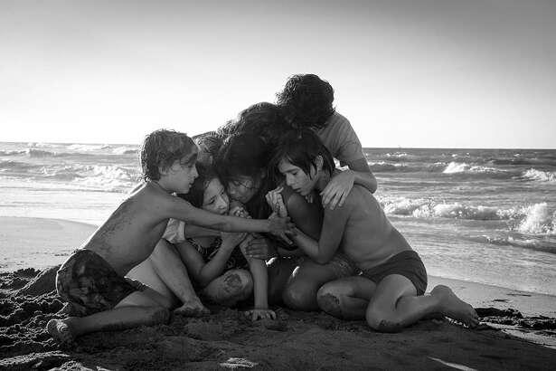 "Marina de Tavira, Marco Graf, Yalitza Aparicio, Daniela Demesa, Diego Cortina Autrey, and Carlos Peralta in ""Roma."" credit: Netflix"