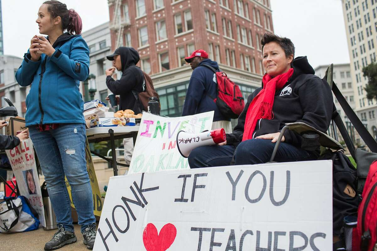 Amy Wilder, Special Education teacher at Oakland High School, protests outside Oakland City Hall.