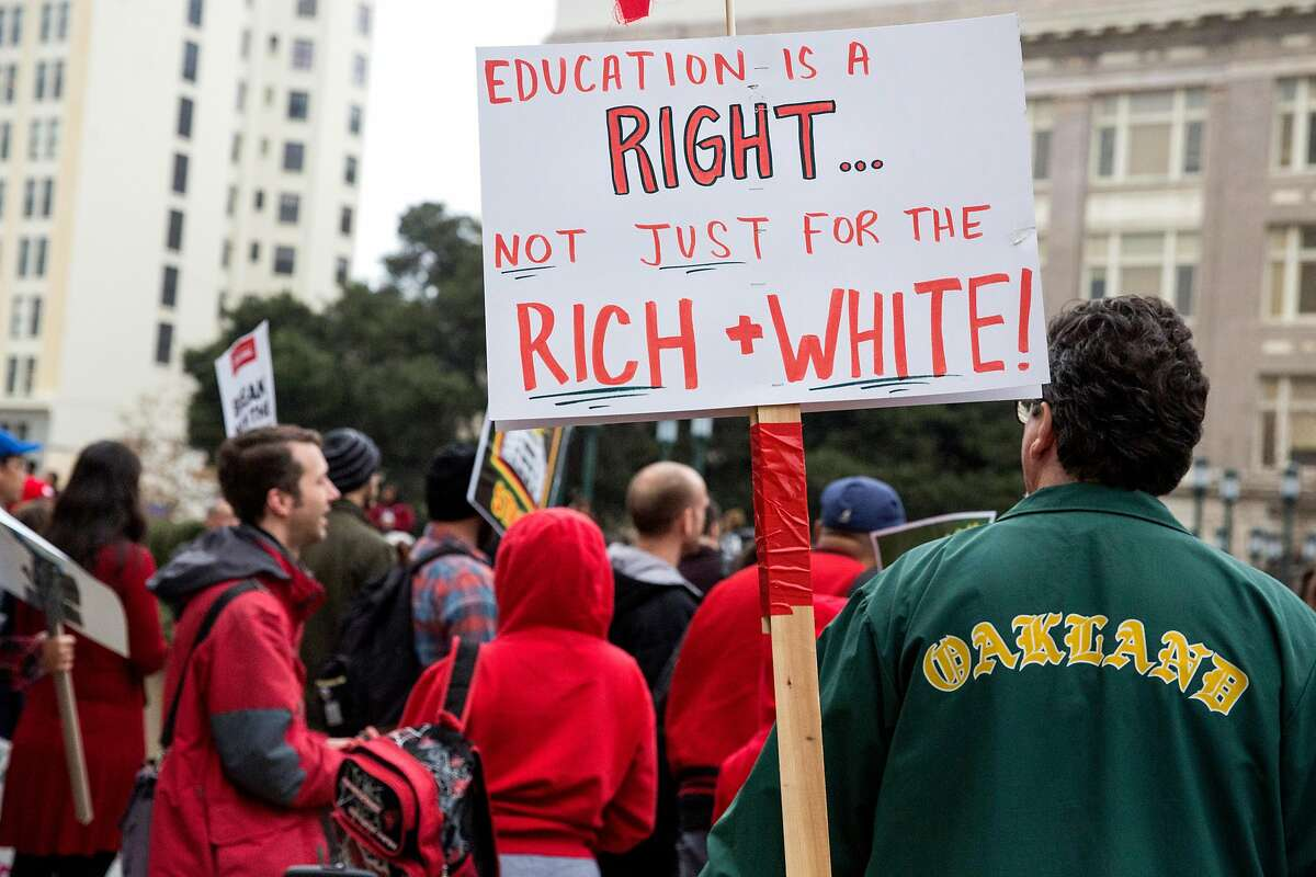 Joined by students and supporters, teachers from Oakland High and other schools, gather to protest their wages outside Oakland City Hall on Monday, December 10, 2018 in Oakland, Calif.