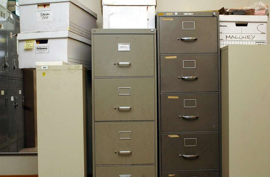 ZODIAC008_pg.jpg File in center with card at top that says Zodiac is the one. SFPD deactivating investigation of Zodiac killer. this is the locked cabinet where the case files and evidence are kept. (they didnt want to open cabinet) 4/6/04 in San Francisco. Penni Gladstone / The Chronicle Photo: Penni Gladstone / The Chronicle