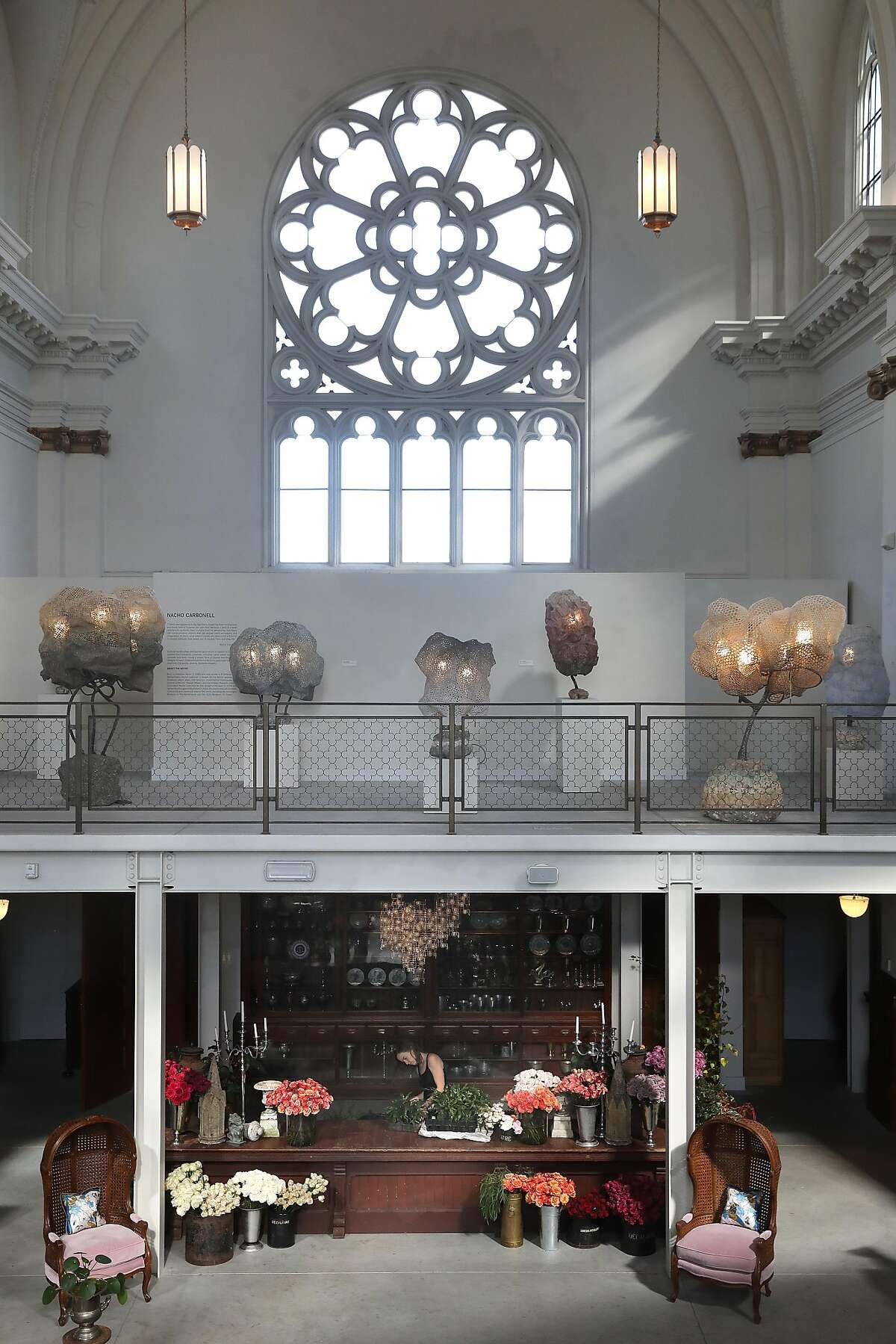 View of sculptures from artist Nacho Carbonell (middle) with floral design table seen below at Saint Joseph's Arts Society on Tuesday, Oct. 16, 2018, in San Francisco, Calif.