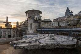 "Disneyland posted this image of construction at ""Star Wars: Galaxy's Edge,"" including a life-size model of Millennium Falcon. The attraction is slated to open in 2019."