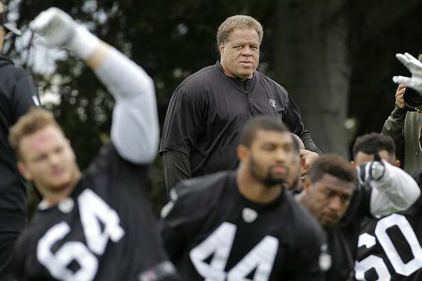 FILE - In this May 13, 2016, file photo, Oakland Raiders general manager Reggie McKenzie watches as players stretch during an NFL football rookie minicamp in Alameda, Calif. The Oakland Raiders have fired general manager Reggie McKenzie less than two years after he was named the NFL's executive of the year. A person familiar with the move says McKenzie was let go on Monday, Dec. 10, 2018, from the position he had held for almost seven seasons. The person spoke on condition of anonymity because the team has not made an announcement. (AP Photo/Jeff Chiu, File)