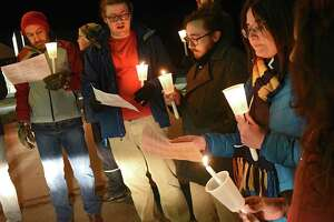 Protesters hold a candlelight vigil outside a fundraiser at Franklin Terrace Ballroom for Mayor Patrick Madden, who opposes efforts to make Troy a sanctuary city on Monday, Dec. 10, 2018 in Troy, N.Y. (Lori Van Buren/Times Union)