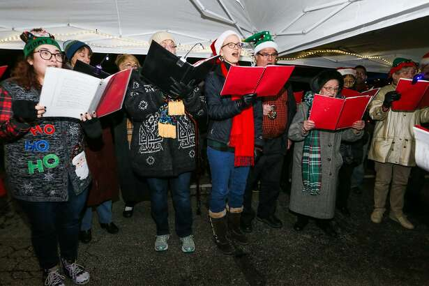 The San Antonio Symphony Master Singers sing carols during the 60th Annual Windcrest Light-Up at City Hall on Saturday.
