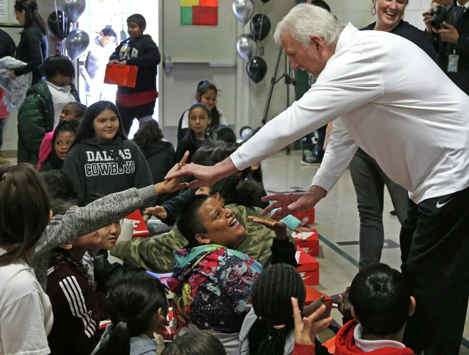 San Antonio Spurs head coach Gregg Popovich greets students Monday at Pershing Elementary School. Popovich and Spurs guard Derrick White were on hand as each student was given a pair of shoes through a donation to Shoes That Fit. Photo: Ronald Cortes /Contributor / 2018 Ronald Cortes
