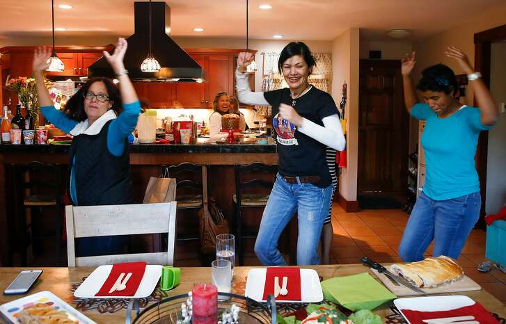 "Candy Brito, Chiquy "" Boom "", Mejia, Isabella Delgado, dance during the traditional Venezuelan holiday gathering at the home of Siury Pulgar, Galipan Catering, in San Jose, Calif., on Nov. 11, 2018. Venezuelan community gathers to celebrate the Christmas holiday with traditional food and music. (Josie Lepe/Special to the Chronicle)"