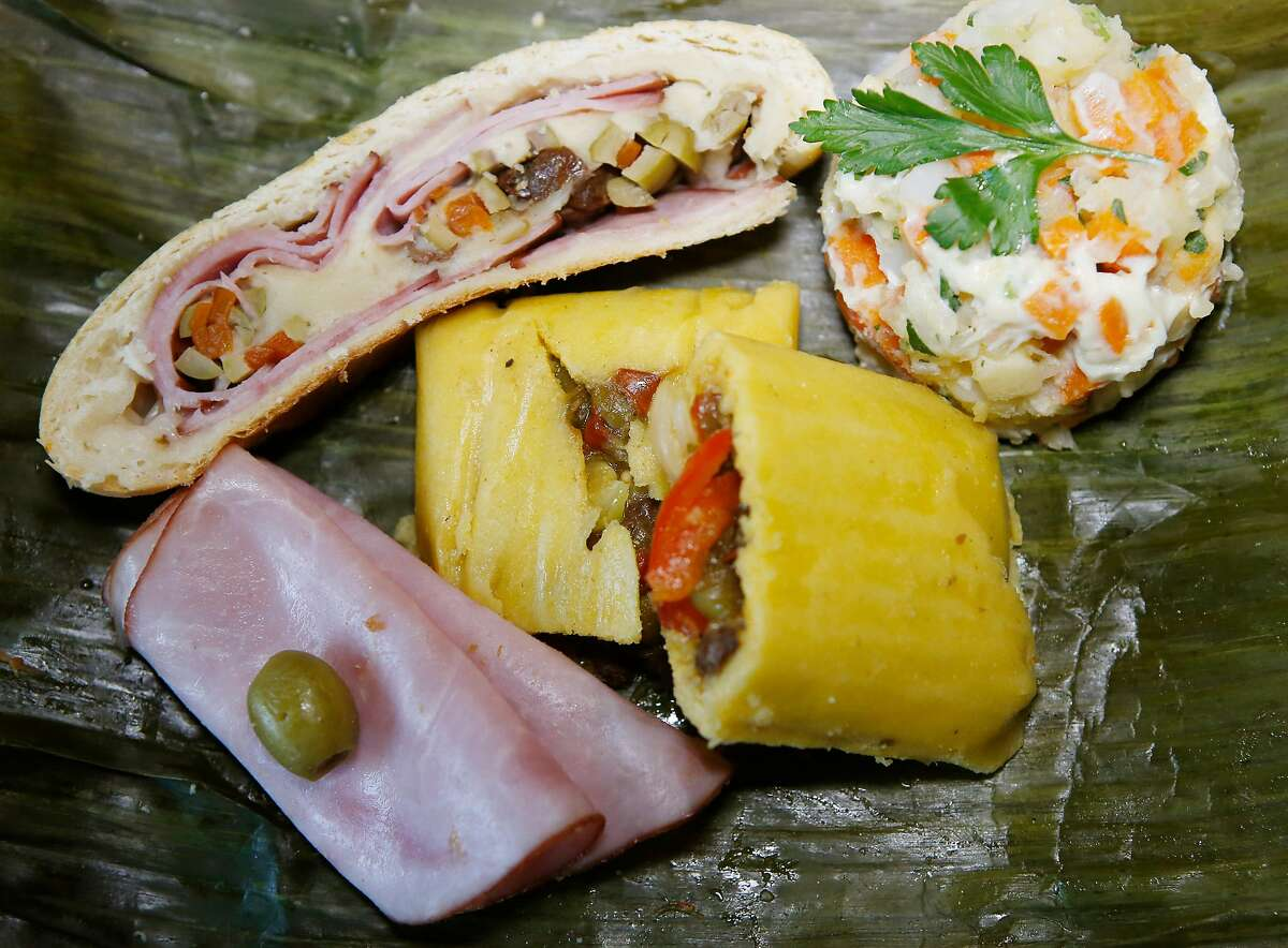 """""""Plato Navide�o"""", Traditional Venezuelan Christmas plate with vegetarian hallacas, ham stuffed bread, """" pan de jamon', hen salad, """" ensaladad de gallina"""", photographed during traditional Venezuelan holiday feast at the home of Siury Pulgar, Galipan Catering, in San Jose, Calif., on Nov. 11, 2018. Venezuelan community gathers to celebrate the Christmas holiday with traditional food and music. (Josie Lepe/Special to the Chronicle)"""