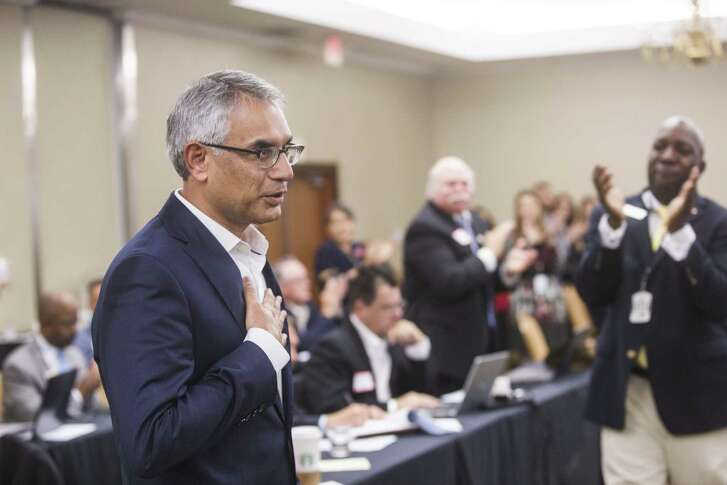Dr. Shahid Shafi, speaks before members of the State Republican Executive Committee, following a vote in favor of resolution that opposes an effort by the Tarrant County Republican Party (TCRP) to remove him as vice chair because of his religion, during the committee's quarterly meeting on Saturday, Dec. 1, 2018, in Austin. Email exchanges involving county Republican leaders in Texas reveal efforts to remove Shafi, a party vice chairman because he's Muslim. (Amanda Voisard/Austin American-Statesman via AP)