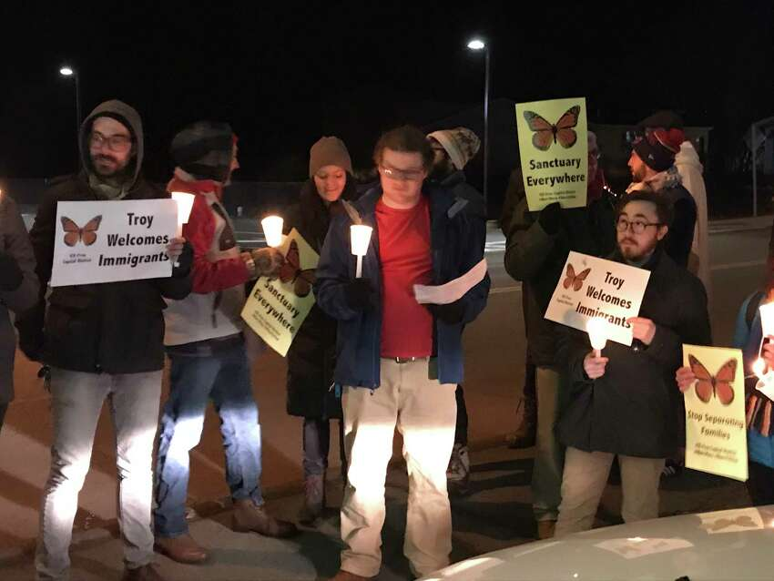 Supporters for declaring Troy, NY a sanctuary city gather outside Mayor Patrick Madden's fund raiser at the Franklin Terrace Ballroom Monday Dec. 10, 2018