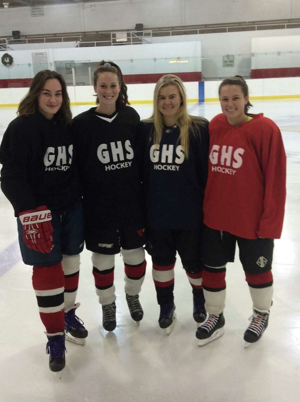 From left to right: Hayley Duffy, Grace Fahey, Jennifer Kelly and Paige Finneran are senior captains on the Greenwich High School girls ice hockey team. The Cardinals won the FCIAC title the past two seasons.