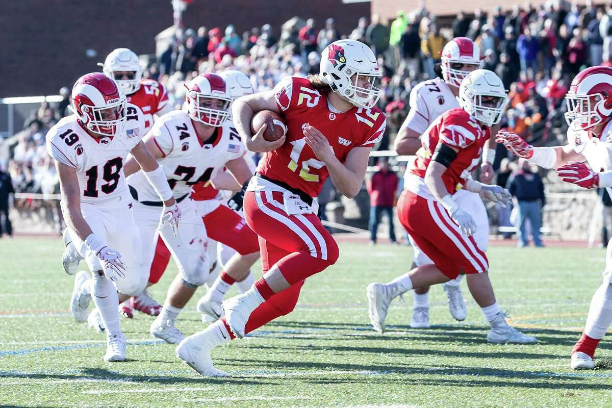 Gavin Muir (12) of Greenwich runs in a touchdown during the Class LL state championship game between on New Canaan and Greenwich on December 8, 2018 at Stamford High School in Stamford, CT.