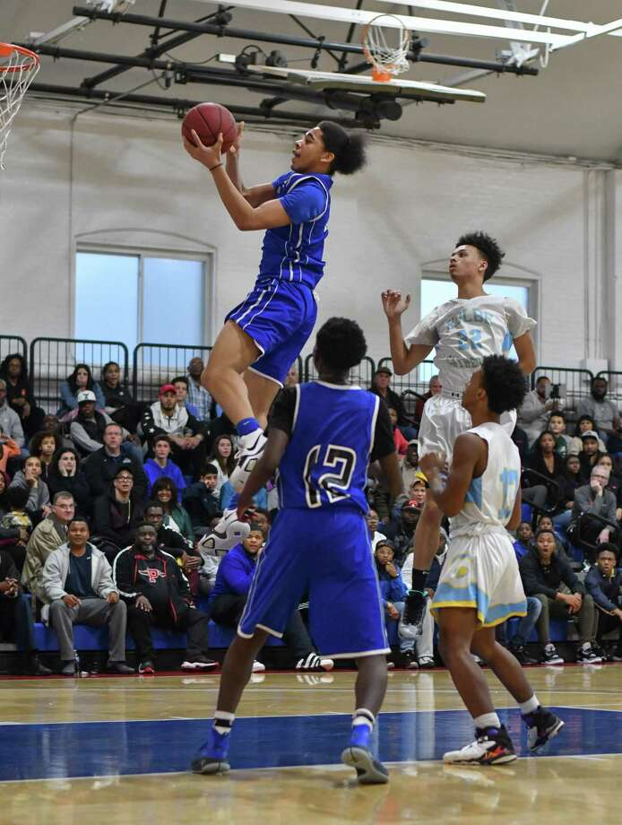Maximus Edwards (2) of the Bunnell Bulldogs sails to the basket during a game against the Kolbe Cathedral Cougars at Shehan Center on Friday February 23, 2018 in Bridgeport, Connecticut. Photo: Gregory Vasil / For Hearst Connecticut Media / Connecticut Post Freelance