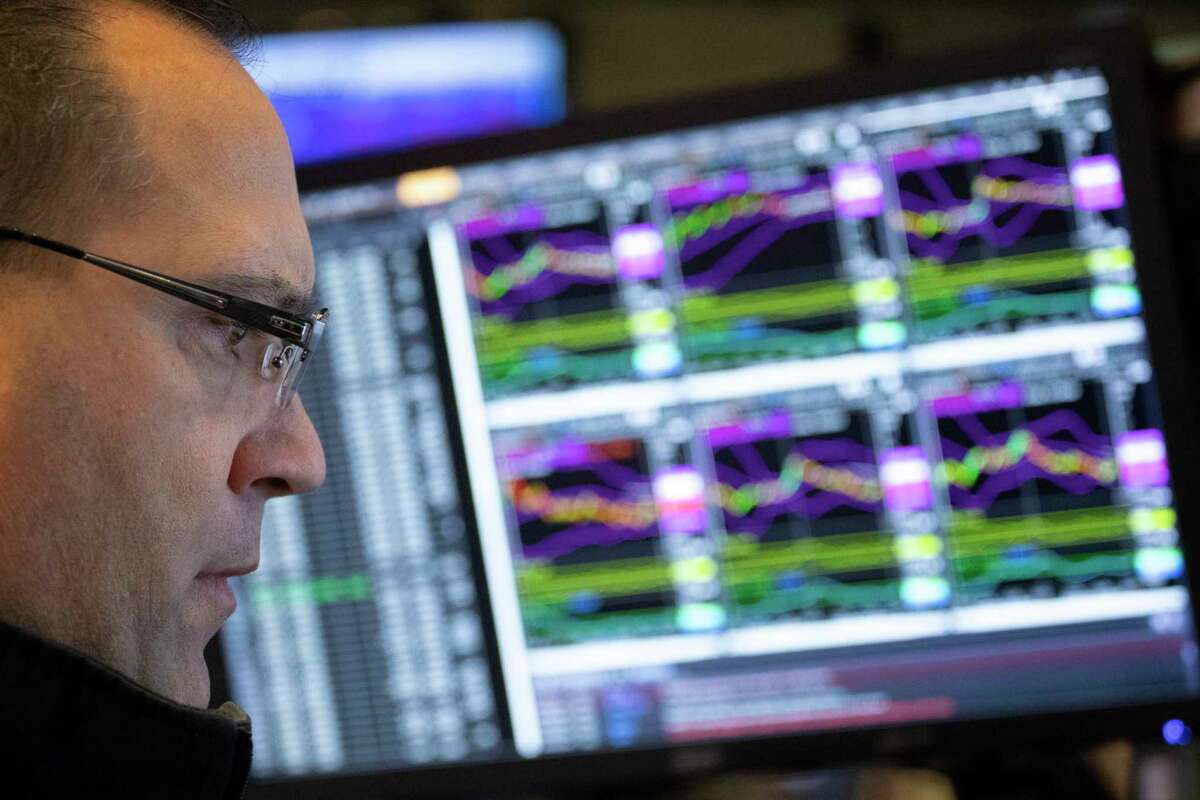 Anthony Matesic, a designated market maker, follows stock prices at the New York Stock Exchange, Monday, Dec. 10, 2018. Stocks are wobbling between small gains and losses in the early going on Wall Street as trading settles down following huge losses last week. (AP Photo/Mark Lennihan)