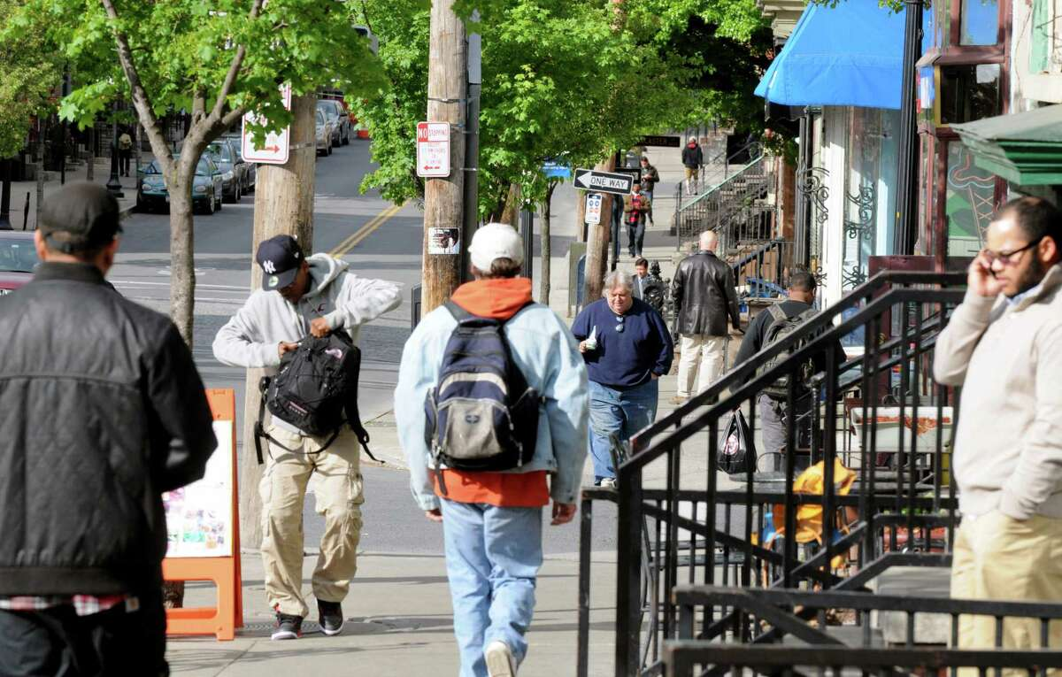 People traverse the Lark Street sidewalks, Monday afternoon May, 13, 2013, in Albany, N.Y. (Will Waldron/Times Union)