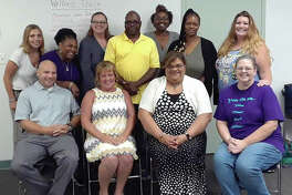 Gift of Voice founder AJ French founder, bottom right, and members of the organization's Wellness Recovery Action Plan (WRAP) Symposium. Gift of Voice - a mental health and trauma recovery training organization - has recently been assigned 501(c)(3) taxed-exempt status from the Internal Revenue Service and now looks to host its first fundraiser.