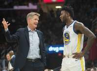 The Golden State head coach Steve Kerr talks with Jordan Bell during Wednesday nights game as the Warriors face the Cavaliers at Quicken Loans Arena in Cleveland on December 5, 2018.  (Kyle Lanzer/Special to The San Francisco Chronicle)