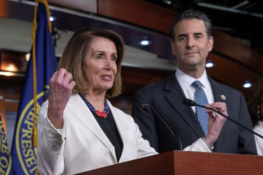In this Nov. 30, 2018 photo, House Minority Leader Nancy Pelosi, D-Calif., is joined by Rep. John Sarbanes, D-Md., at a news conference to discuss their priorities when they assume the majority in the 116th Congress in January, at the Capitol in Washington. While tea party Republicans swept to power to stop things -- repeal Obamacare, roll back environmental regulations and decrease the size and scope of government -- Democrats are marching into the majority to build things back up. And after spending eight downcast years in the minority, they can?'t wait to get started. (AP Photo/J. Scott Applewhite)
