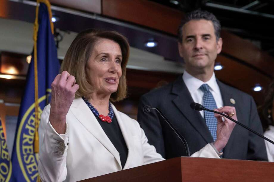 In this Nov. 30, 2018 photo, House Minority Leader Nancy Pelosi, D-Calif., is joined by Rep. John Sarbanes, D-Md., at a news conference to discuss their priorities when they assume the majority in the 116th Congress in January, at the Capitol in Washington.  While tea party Republicans swept to power to stop things -- repeal Obamacare, roll back environmental regulations and decrease the size and scope of government -- Democrats are marching into the majority to build things back up. And after spending eight downcast years in the minority, they can't wait to get started.   (AP Photo/J. Scott Applewhite) Photo: J. Scott Applewhite / Copyright 2018 The Associated Press. All rights reserved