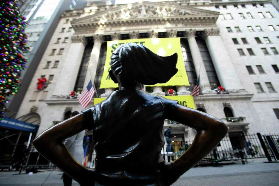 """The """"Fearless Girl"""" statue is unveiled at its new location in front of the New York Stock Exchange, Monday, Dec. 10, 2018, in New York. The statue, considered by many to symbolize female empowerment, was previously located near the Charging Bull statue on lower Broadway. (AP Photo/Mark Lennihan) Photo: Mark Lennihan / Copyright 2018 The Associated Press. All rights reserved."""