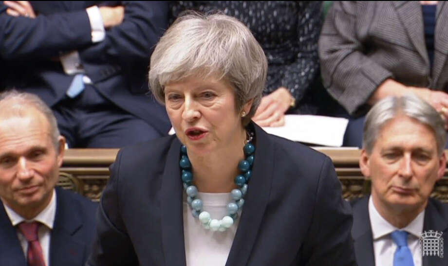 In this grab taken from video, Britain's Prime Minister Theresa May makes a statement in the House of Commons, in London, Monday, Dec.  10, 2018.  May has postponed Parliament's vote on her European Union divorce deal to avoid a shattering defeat _ a decision that throws her Brexit plans into chaos. (PA via AP) Photo: PARBUL / PA