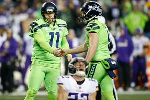 SEATTLE, WA - DECEMBER 10: Sebastian Janikowski #11 and Michael Dickson #4 of the Seattle Seahawks celebrate a field goal in the third quarter as Harrison Smith #22 of the Minnesota Vikings screams in frustration at CenturyLink Field on December 10, 2018 in Seattle, Washington. (Photo by Otto Greule Jr/Getty Images)