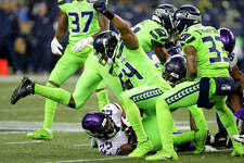 Seattle Seahawks' Bobby Wagner (54) raises his fist after stopping Minnesota Vikings' Latavius Murray on a fourth down run in the second half of an NFL football game, Monday, Dec. 10, 2018, in Seattle. (AP Photo/Stephen Brashear)