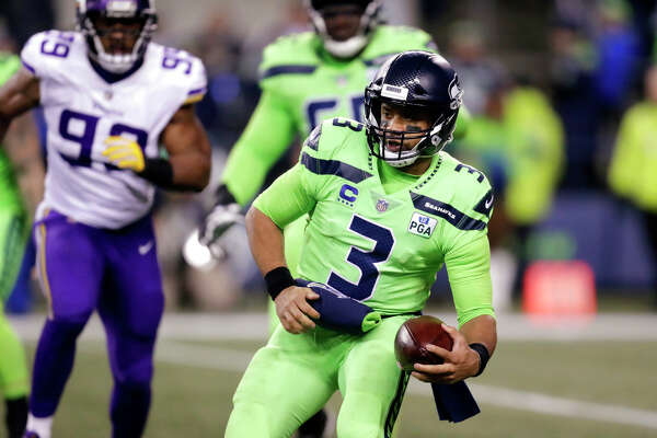 Seattle Seahawks quarterback Russell Wilson runs with the ball against the Minnesota Vikings in the second half of an NFL football game, Monday, Dec. 10, 2018, in Seattle. (AP Photo/Stephen Brashear)
