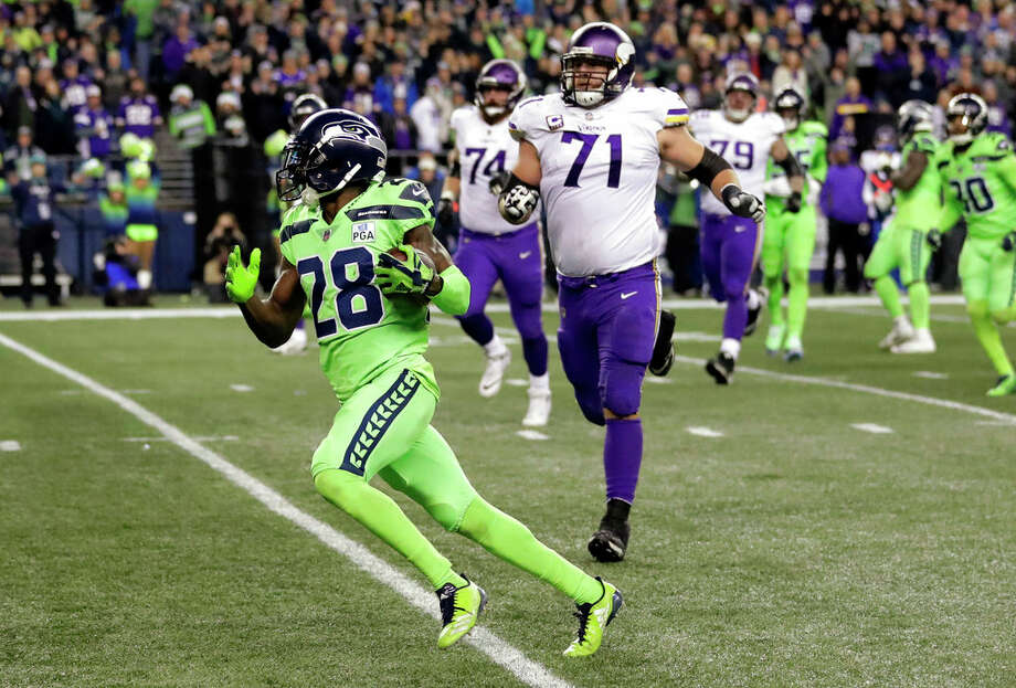 Seattle Seahawks' Justin Coleman (28) races past Minnesota Vikings' Riley Reiff (71) for a touchdown on a recovery from a Vikings' fumble in the second half of an NFL football game, Monday, Dec. 10, 2018, in Seattle. (AP Photo/Ted S. Warren) Photo: Ted S. Warren/AP / Copyright 2018 The Associated Press. All rights reserved.